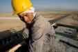 Uzbek workers build a signal station on the new railway spur between Mazar-e-Sharif and Uzbekistan.