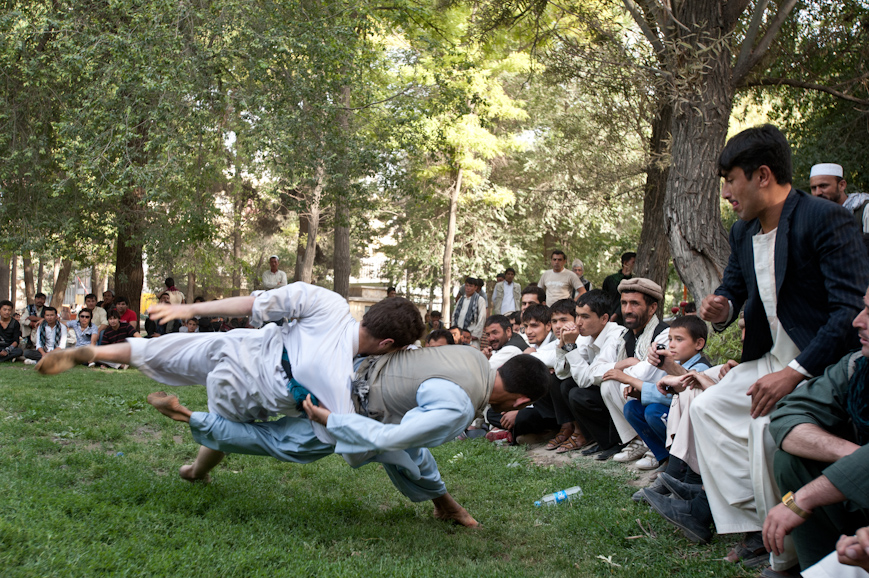 Men gamble on a Karate match in Shar-e-Now Park in downtown Kabul. Under the Taliban government, activities involving gambling and most forms of play were strictly forbidden, including favorite pastimes like bird and dog fighting.