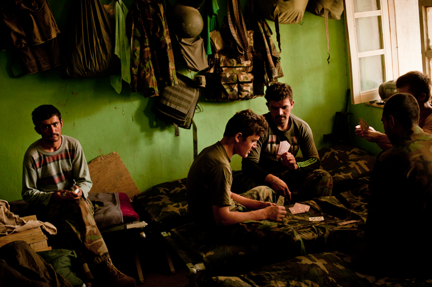 Afghan National Army soldiers play cards at COP Nolen, in Arghandab District.