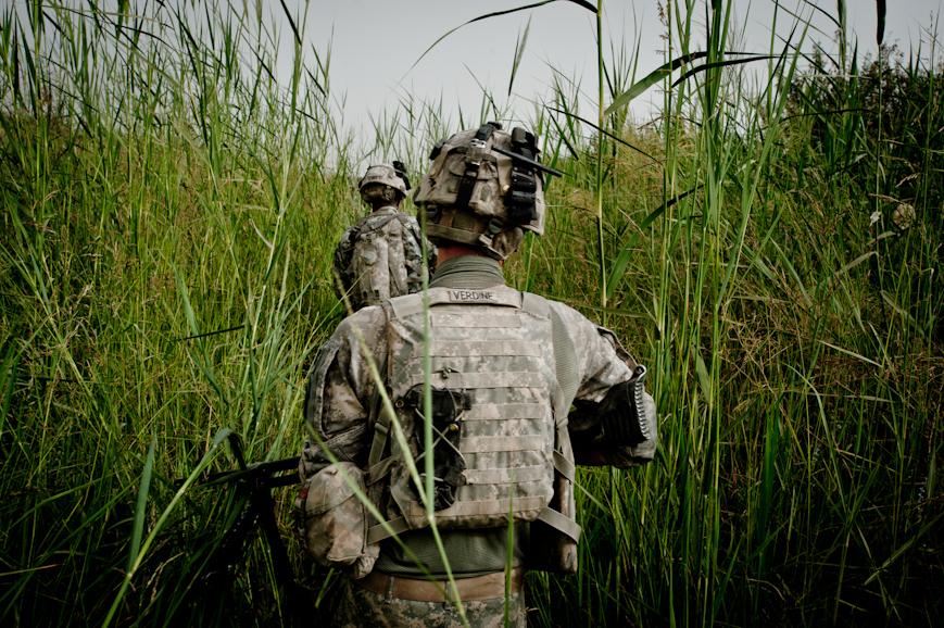 Tall grasses in a muddy field immediately on the outside of COP Nolen's walls make visibility very poor; on this patrol, Alpha Battery soldiers found three improvised explosive devices just meters from their base.