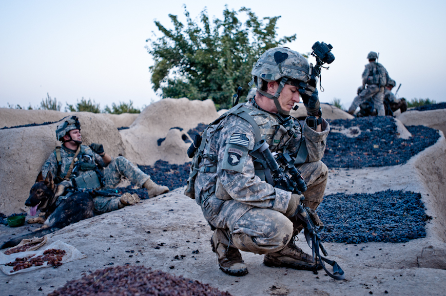 Captain Jeffrey Aebischer became frustrated early on the first morning of the operation to Nur Muhammad Kalache because battalion intelligence misled his men to believe the village would be abandoned and inhabited only by Taliban; once he realized that the village was teeming with civilian families, he feared that Alpha Battery's presence would put them in danger by drawing Taliban fire. Several hours from the moment this photo was taken, his fears proved true.